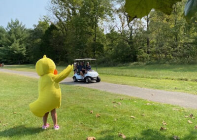 the duck waving to golf cart